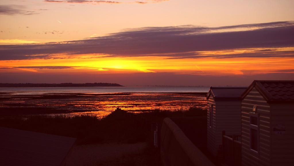 sunset with beach huts by quietpurplehaze