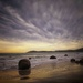 Storm coming over Moeraki Boulders New Zealand by maureenpp
