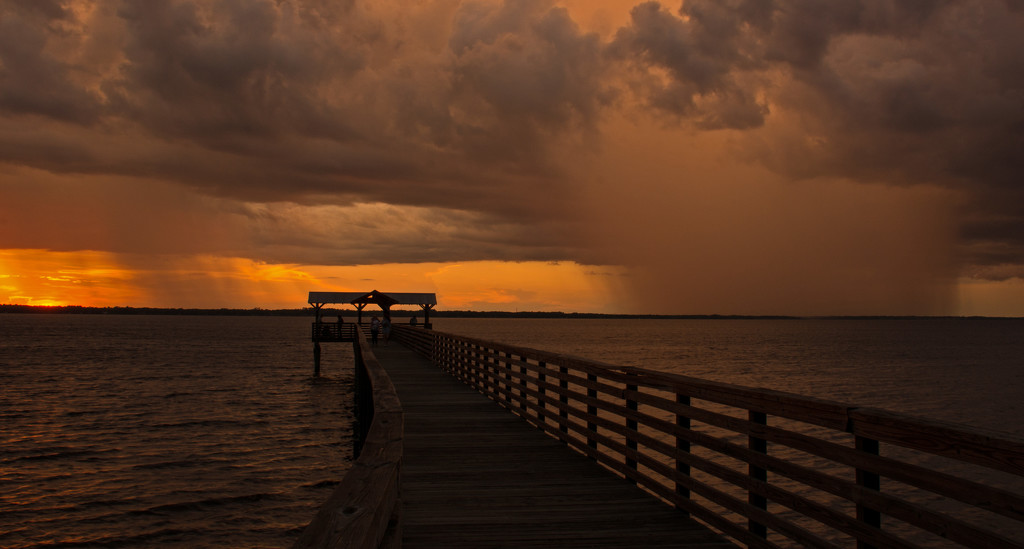 Sunset on the Left, Rain Storm on the Right! by rickster549