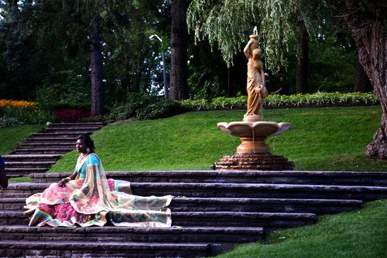 a girl by the fountain by summerfield
