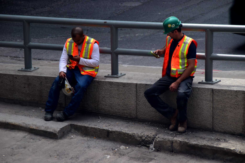 hard hats, cellphones and reflectors by summerfield