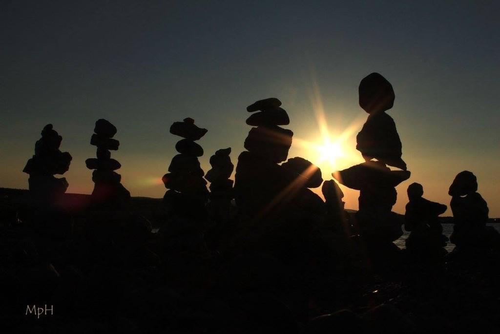 Stone people watching sunset by cherrymartina