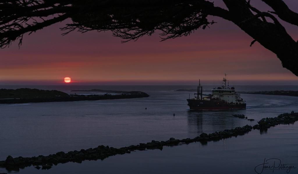 Dredge At Sunset by jgpittenger