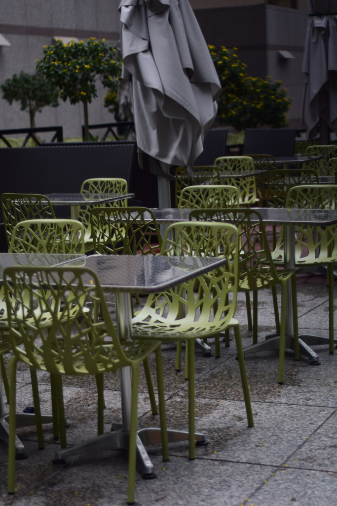 empty chairs at empty tables by summerfield
