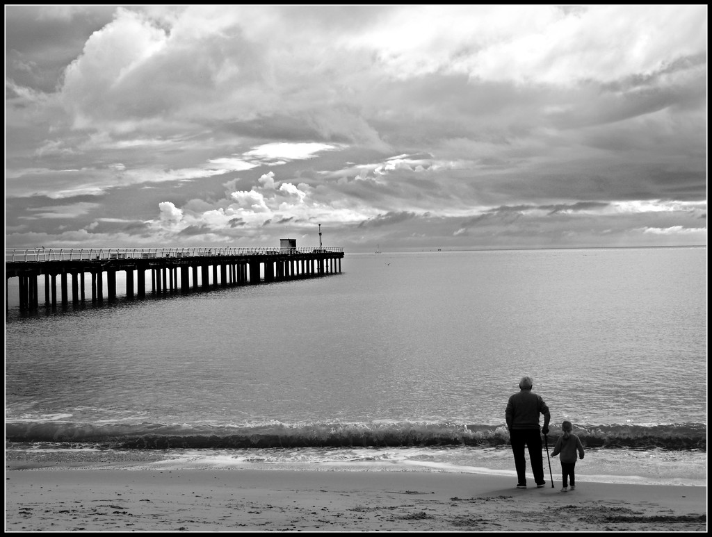 Old man and grandson watching the sea. by janemartin