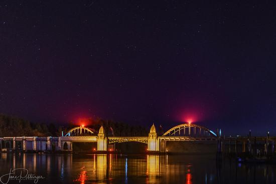 Siuslaw River Bridge At Night by jgpittenger