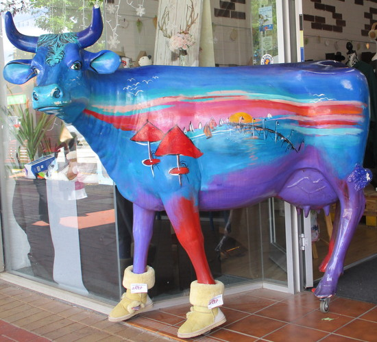 Amazed to see this cow coming out of a shop by 777margo