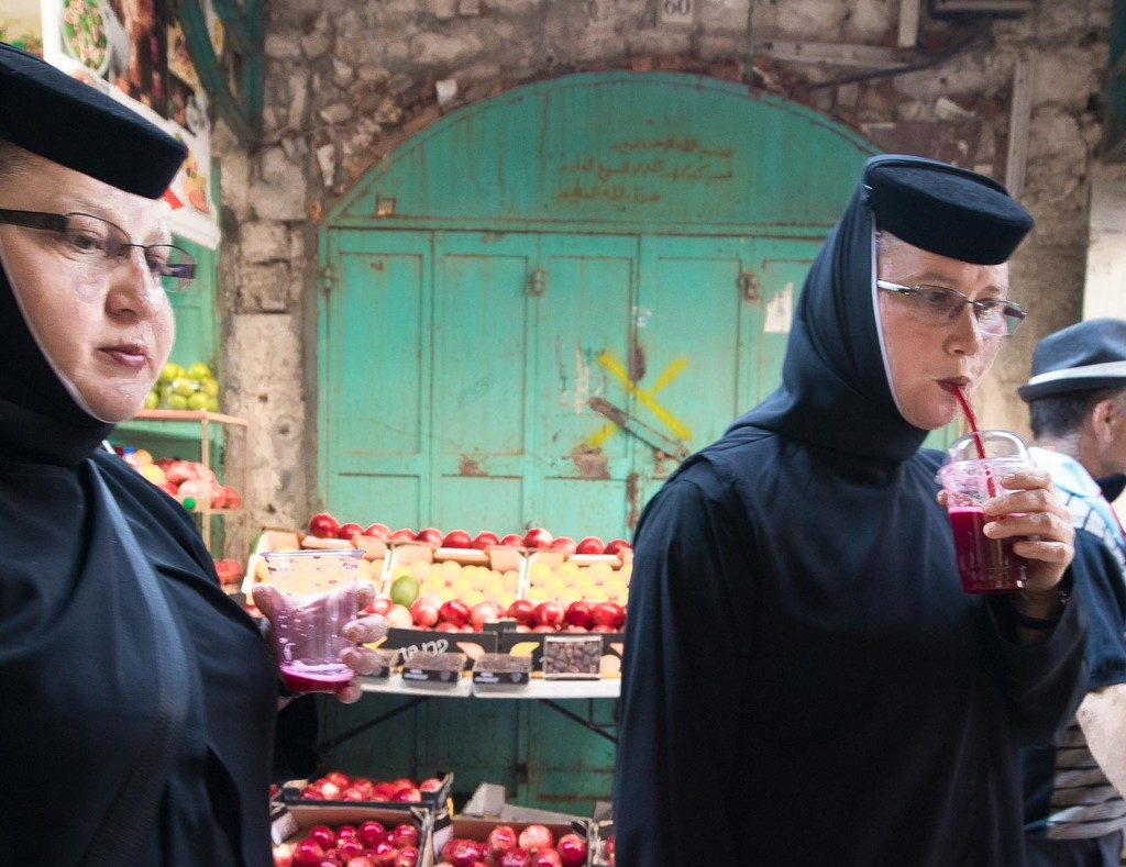 Nuns passing by Tourquoise Door by jyokota