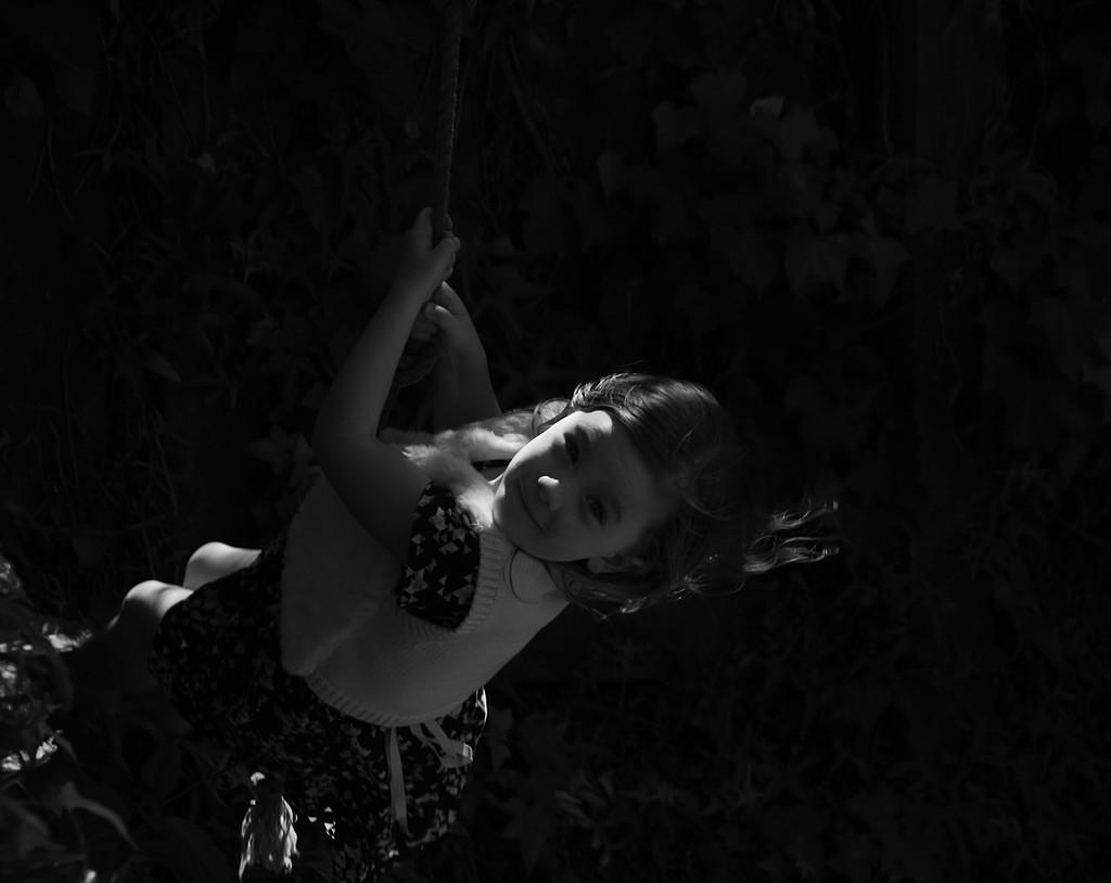 Girl on a swing by kiwinanna