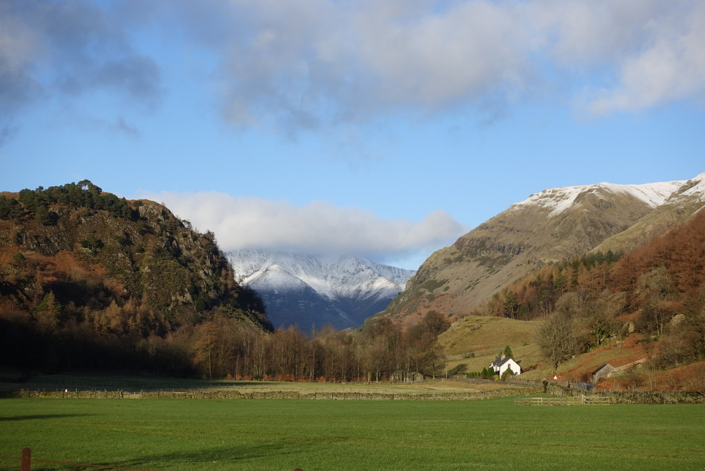 Distant snow topped hill by johnsutton