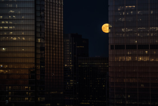 Super Moon Joins the Skyscrapers by taffy