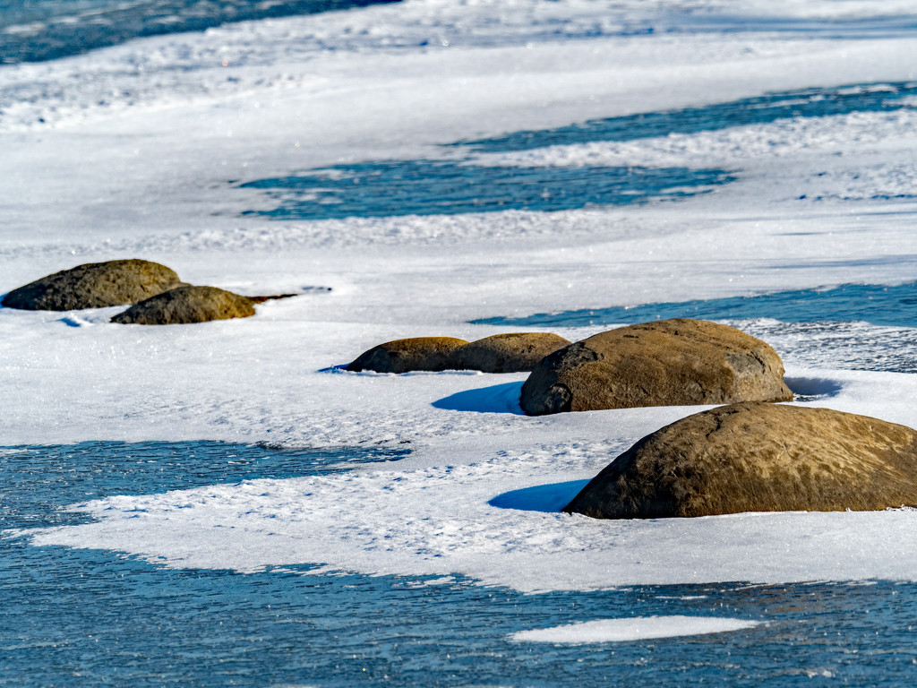 Stones on a frozen lake by rminer