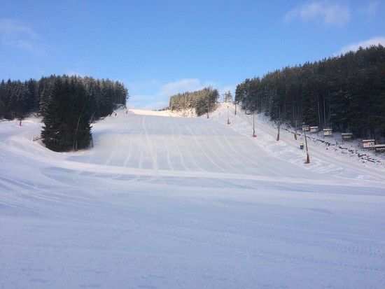 Blue skies and skiing by huvesaker