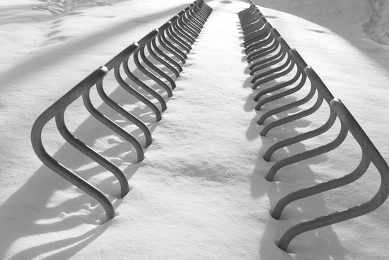 Bicycle rack in snow by primitiveprobe