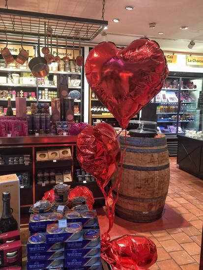 Red hearts in a shop.  by cocobella
