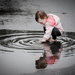 Toddler and a Puddle by jnorthington