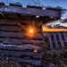 sunset through old pallets by aecasey