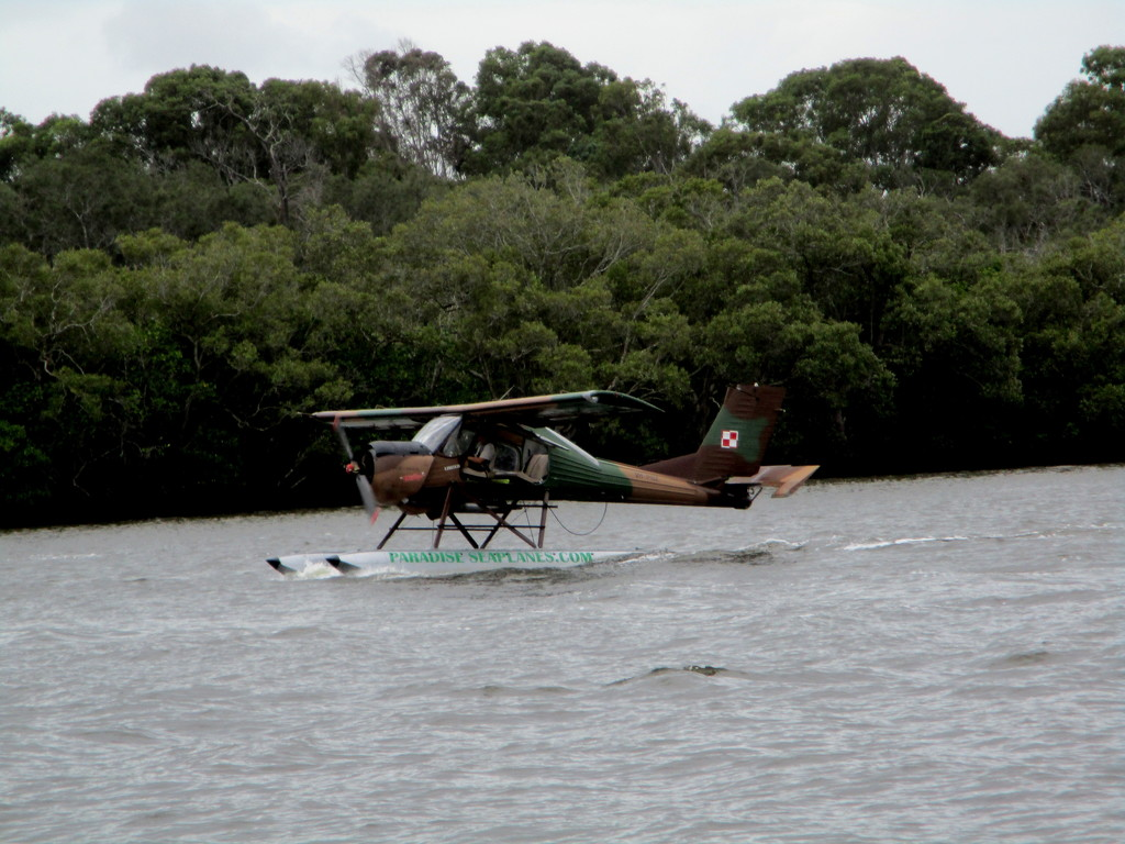 Light aircraft for taking tourists for a trip along the Maroochy River by 777margo