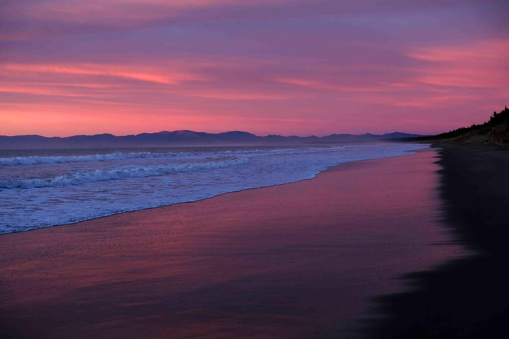 Pale pink sunrise at Waikuku Beach by maureenpp