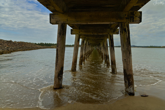Under the Winchester Bay Pier by jgpittenger