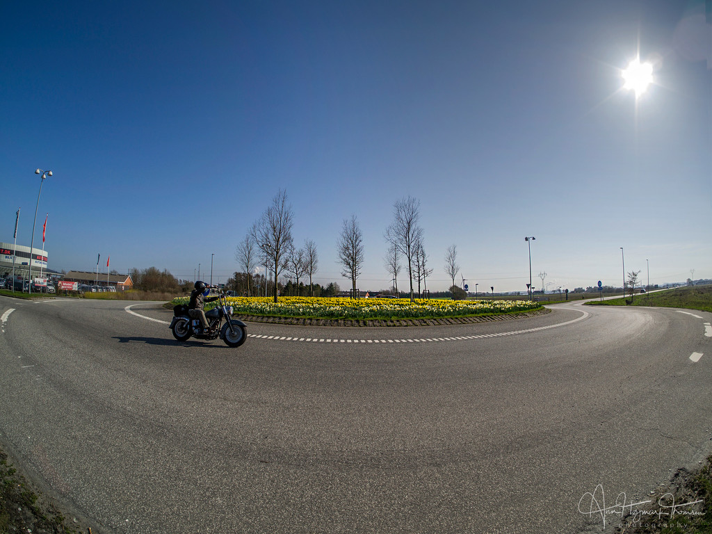 The biker, the fish-eye and the roundabout… by atchoo