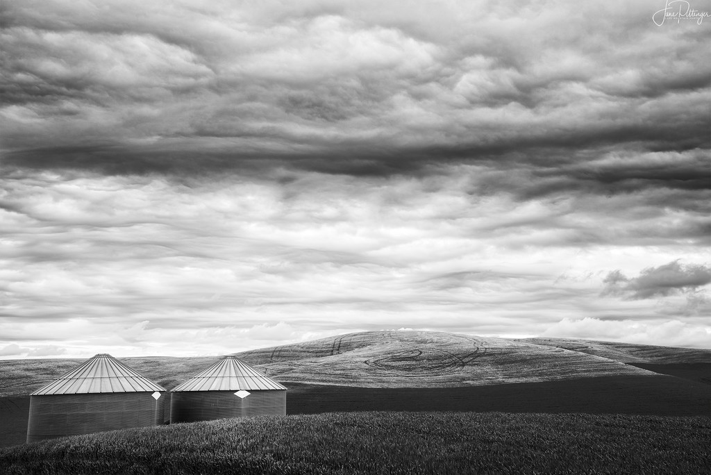 Black and White Silos and Clouds by jgpittenger