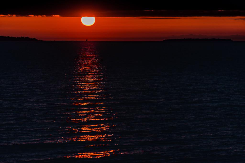Same Sun Sets Over Beaver Island by taffy
