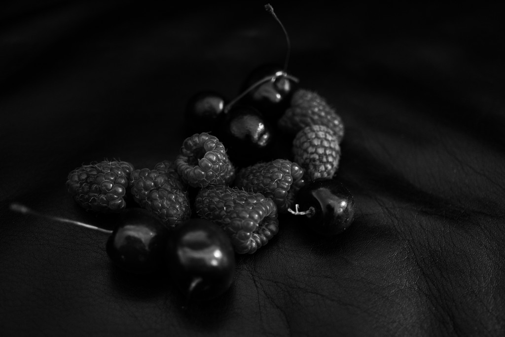 Red fruit in black by cristinaledesma33