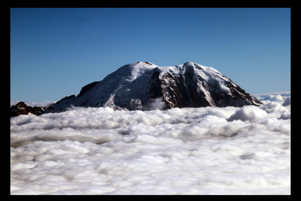Mt Rainier - Above the Clouds by hjbenson