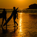 Sunset Surfers at Portreath, Cornwall.