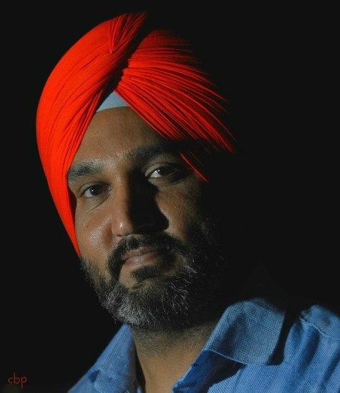Sikh with a red turban  by caterina