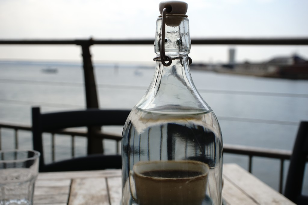 on the waterfront: cup of coffee in a bottle by quietpurplehaze