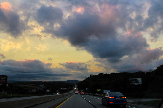 Pretty sky on the highway by mittens