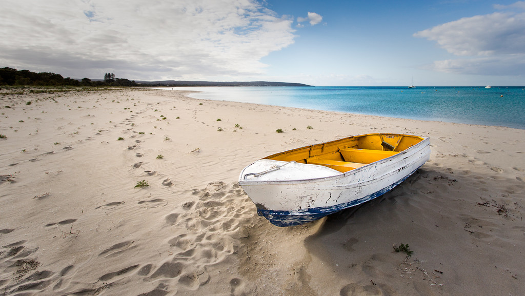 Boat on the beach by the bay by jodies