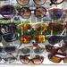 G for gafas( Spanish for glasses)