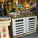 Worker Arranging Mushrooms in a Paris Fresh Market