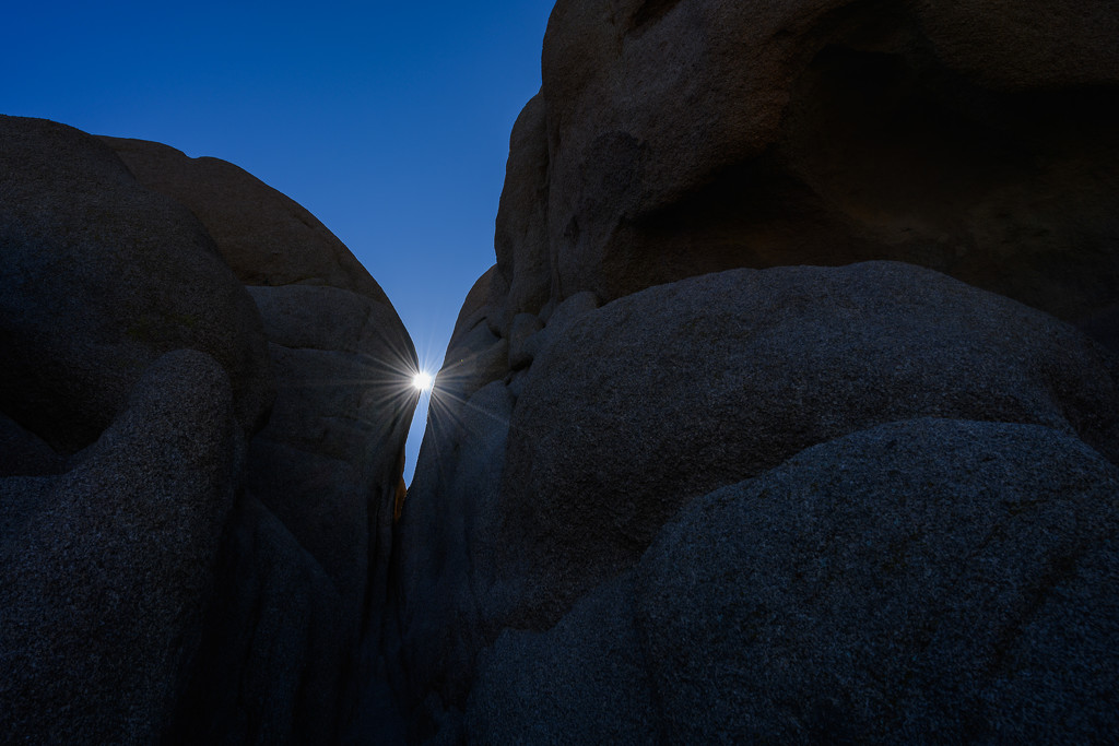 Sun Rises Between Big Rocks by taffy