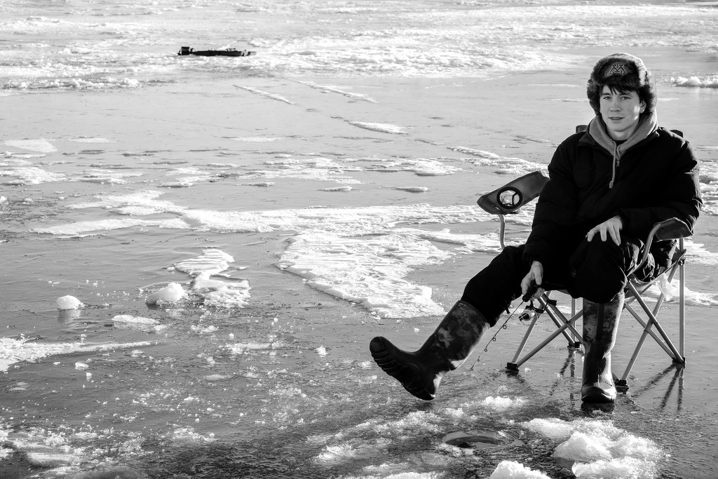 Young Man Ice Fishing by tosee