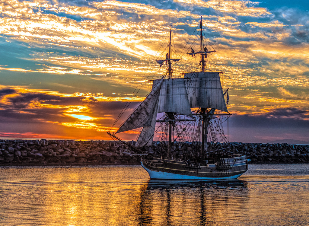 Tall Ship at Sunset by stray_shooter