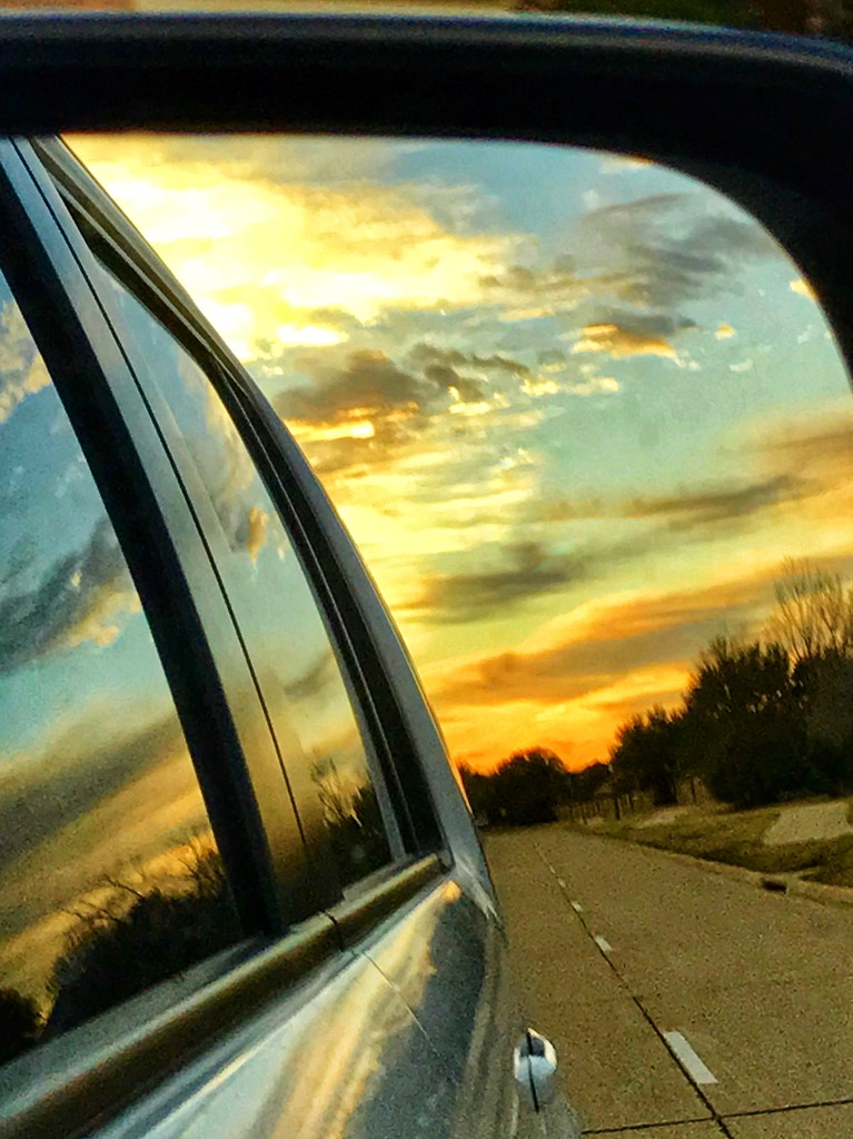 A rear view mirror sunrise on a cold January day by louannwarren