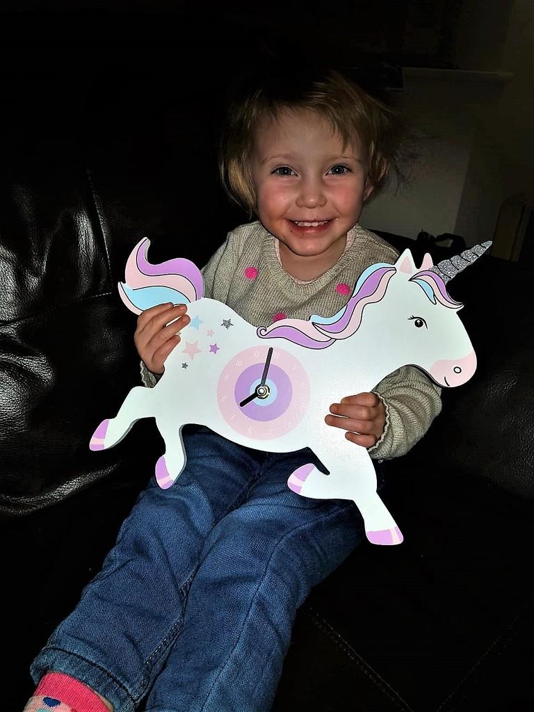 Niamh with her Unicorn Clock by susiemc