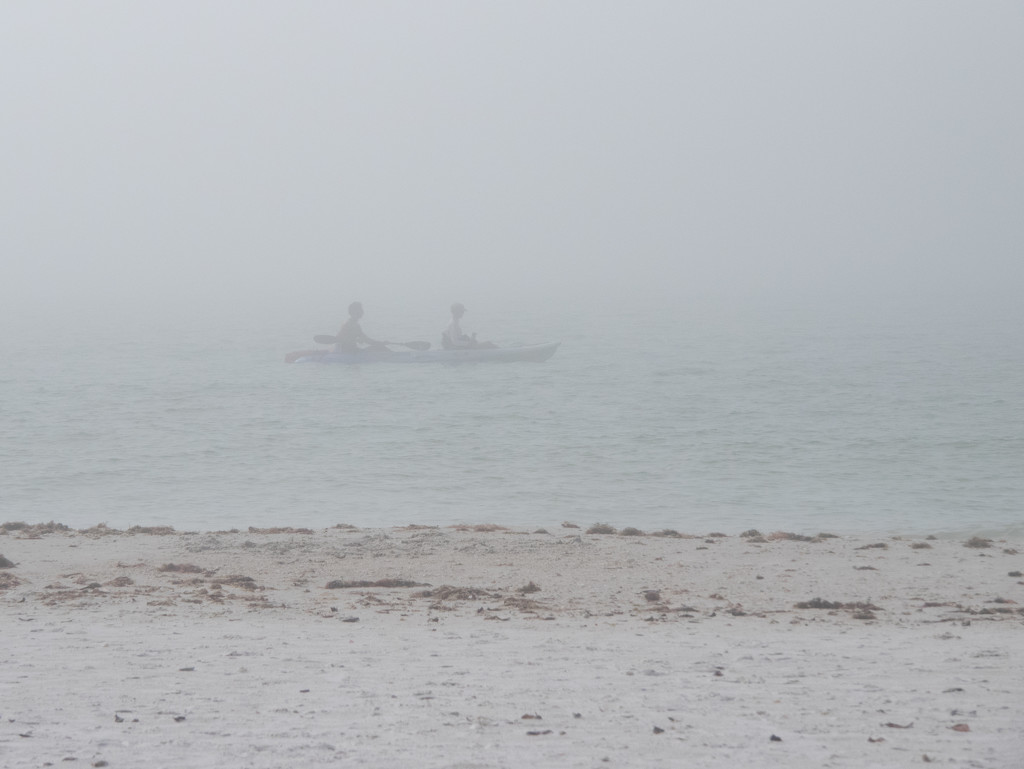 Ghost kayak in the fog by christinemgrote
