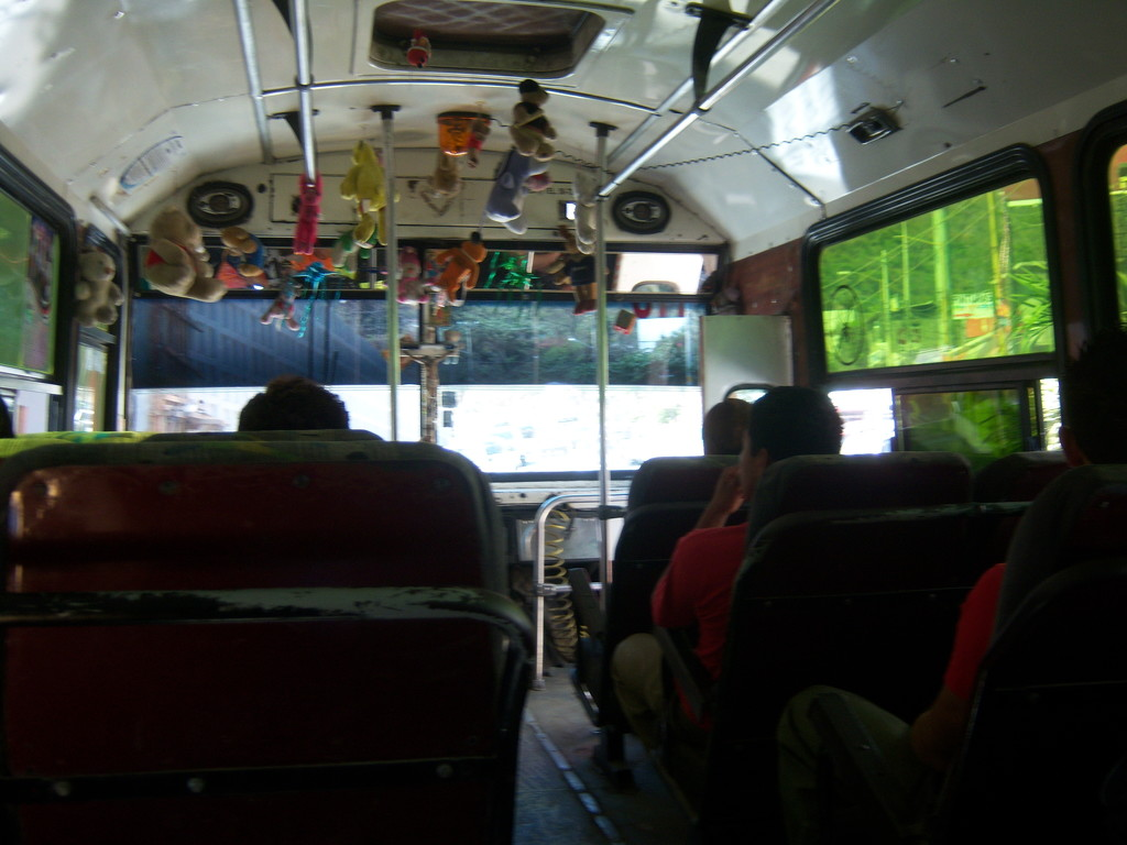 A bus with plush toys hanging from the ceiling by bruni
