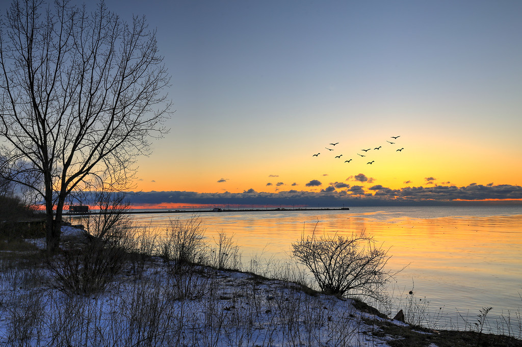 Winter Sunrise Over Lake Ontario by pdulis