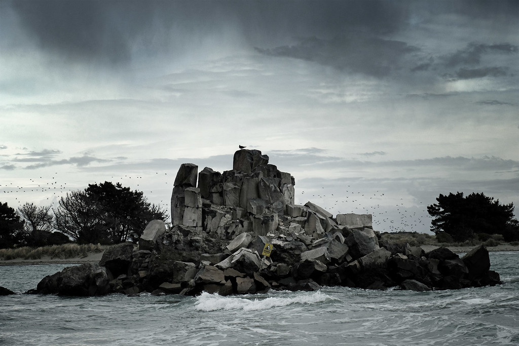 Rain clouds over the rock by maureenpp