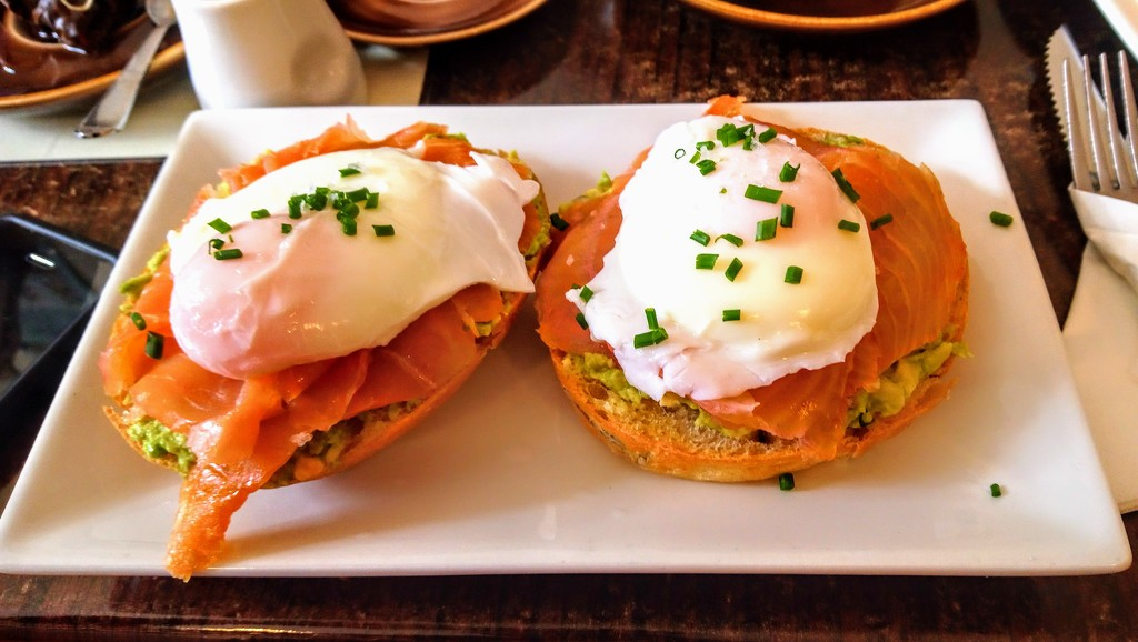 Smashed avocado, smoked salmon and poached eggs on foccacia in Evelina's Patisserie by boxplayer