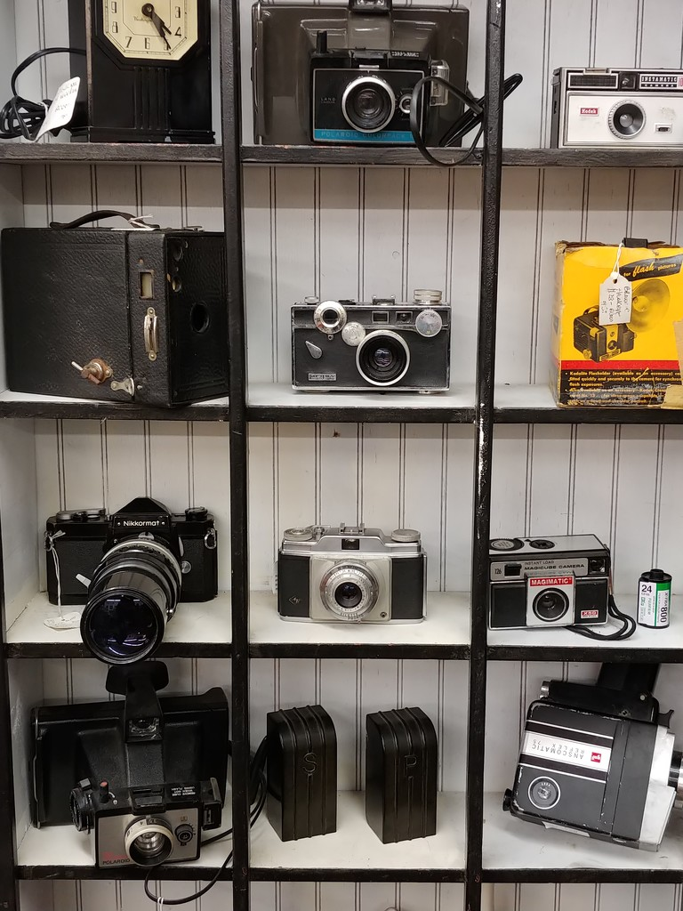 Cameras And A Clock For Sale  by jo38