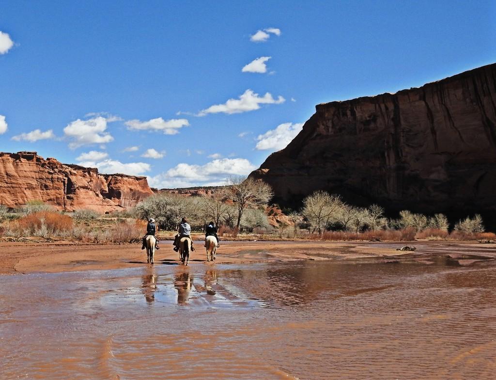 Horseback Riders Entering Canyon de Chelly, Arizona by janeandcharlie