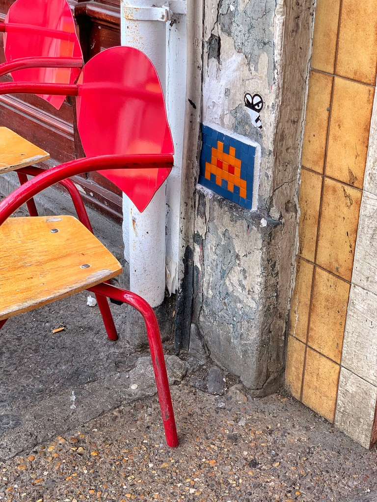 Space invader behind the chair.  by cocobella