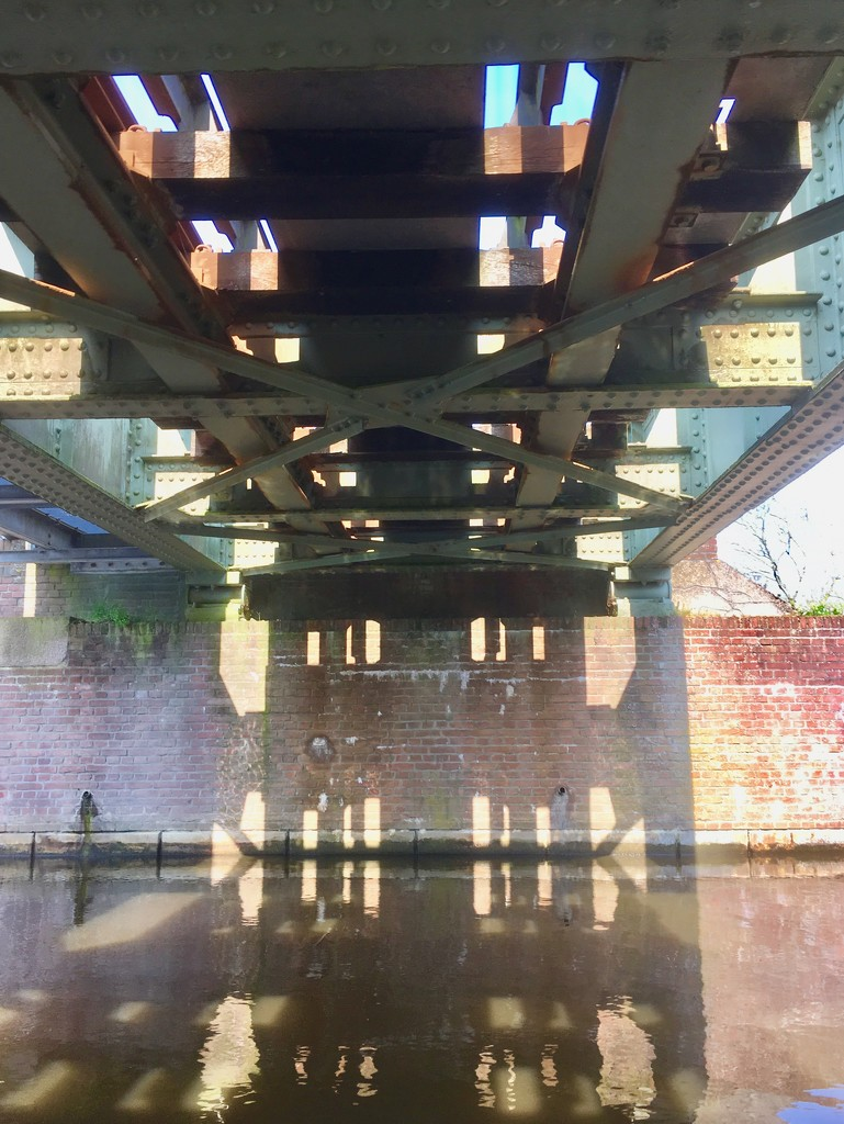Under the bridge lays the beauty shadow reflections  by stimuloog